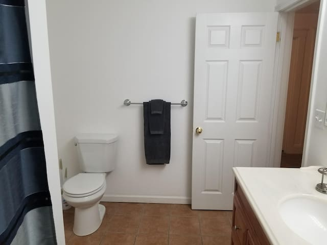 Pictured is entrance to full size bath which is located 4 steps from entrance of private bedroom .