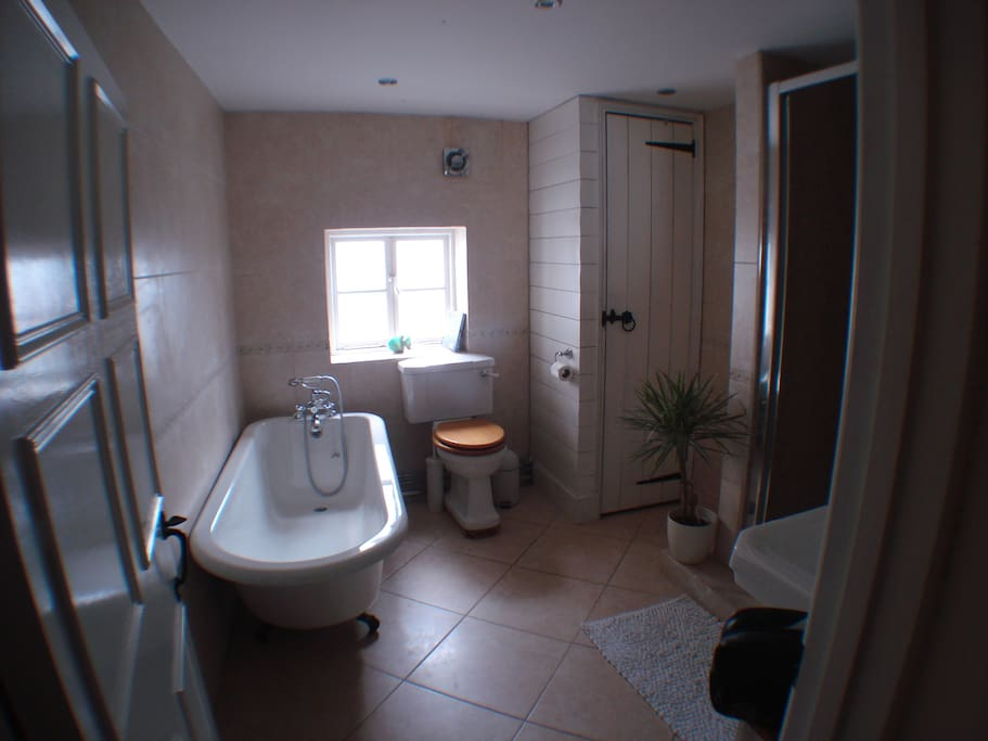 The bathroom with roll top bath and separate shower cubicle. This is supplemented by a downstairs cloakroom.