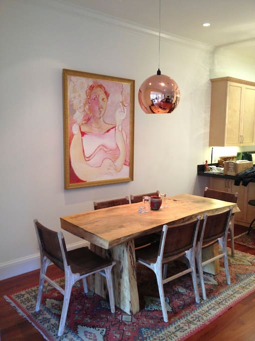 Dining room table adjacent to kitchen for fun filled meal times.