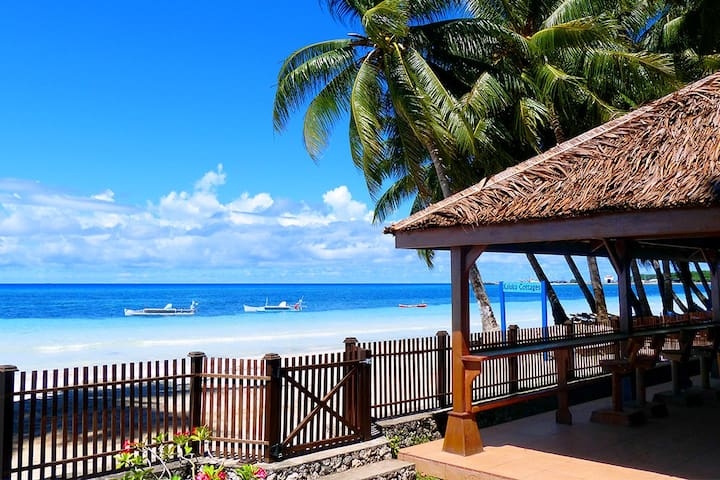 Just 3 steps out our front gate and you are on the beach. You can see Bira Harbour in the distance.