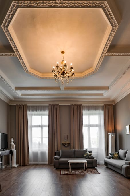 Living room with historical ceiling and chandelier