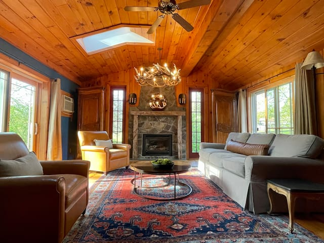Living space with ample seating and large fireplace