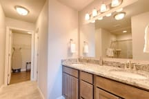 Dual vanities in the attached master bathroom.