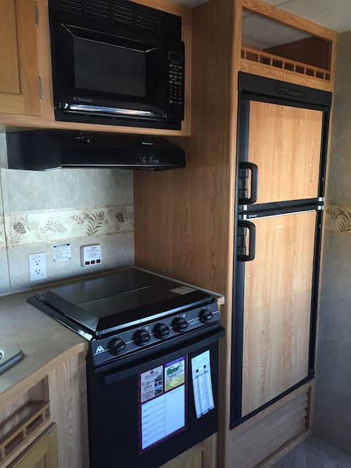 Kitchen stove and refrigerator.