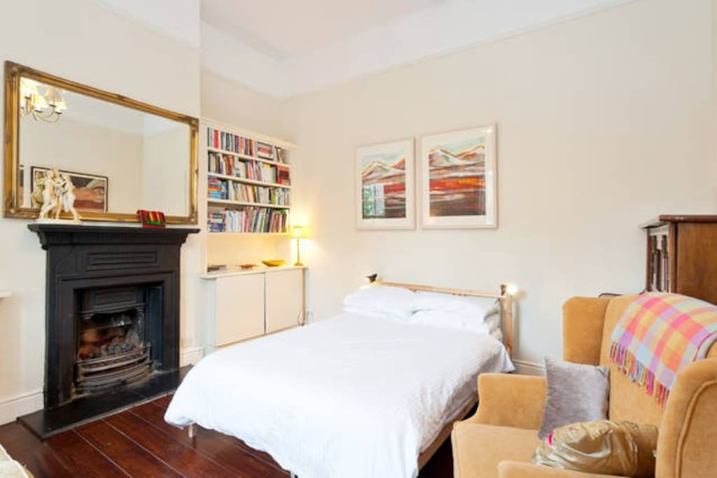 Bedroom one - a very large bright room with a new excellent quality bed as well as a sofa and a piano