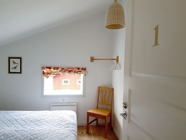 The second bedroom is a bit smaller, it has two single beds that can be put together or separated.