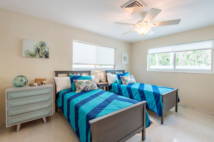 Twin bedroom is perfect for the kids and has large walk in closet.
