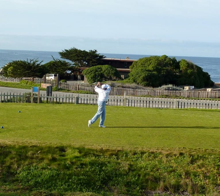The par 5, #12 hole of the Pacific Grove Golf Links was named Rocky Shores after our home (seen behind the golfer.) This course is one of the best ocean-view golf bargains in the United States.