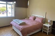 The master queen bedroom with ample natural light and double glazed windows to ensure a peaceful nights sleep.