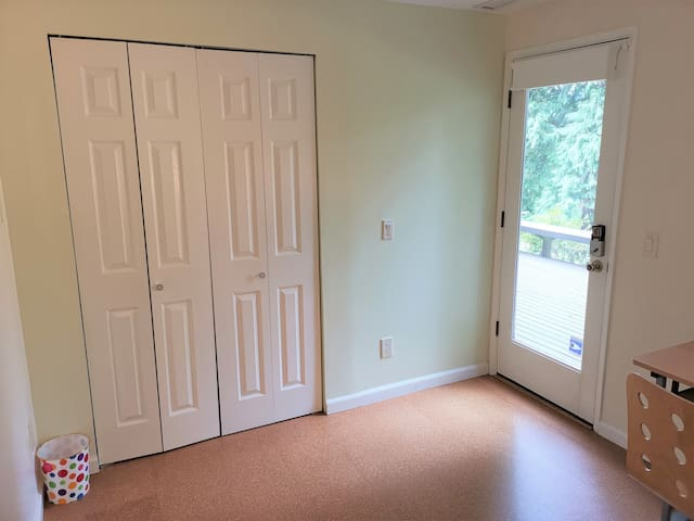 Private keypad entry and ample closet space. Door opens onto deck with patio seating. This is the Primary entry door to the suite.