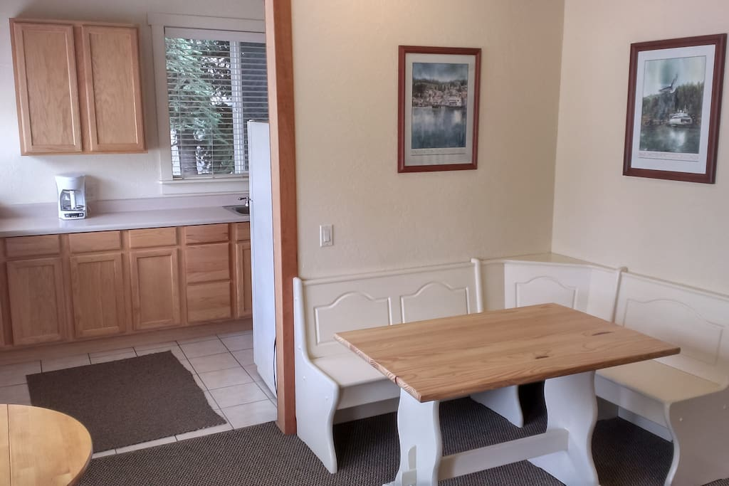 Breakfast nook looking into kitchen area. Play games, do puzzles, family/friends time.
