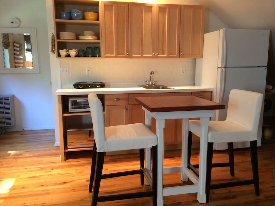 Kitchen with table and stools for two