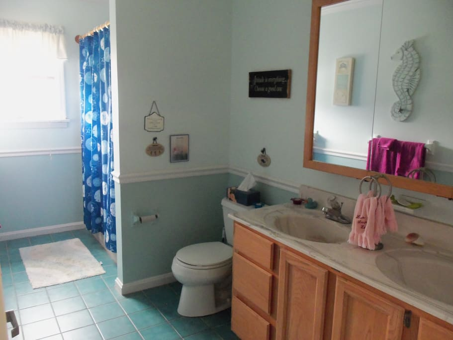 Full bathroom with double sinks.