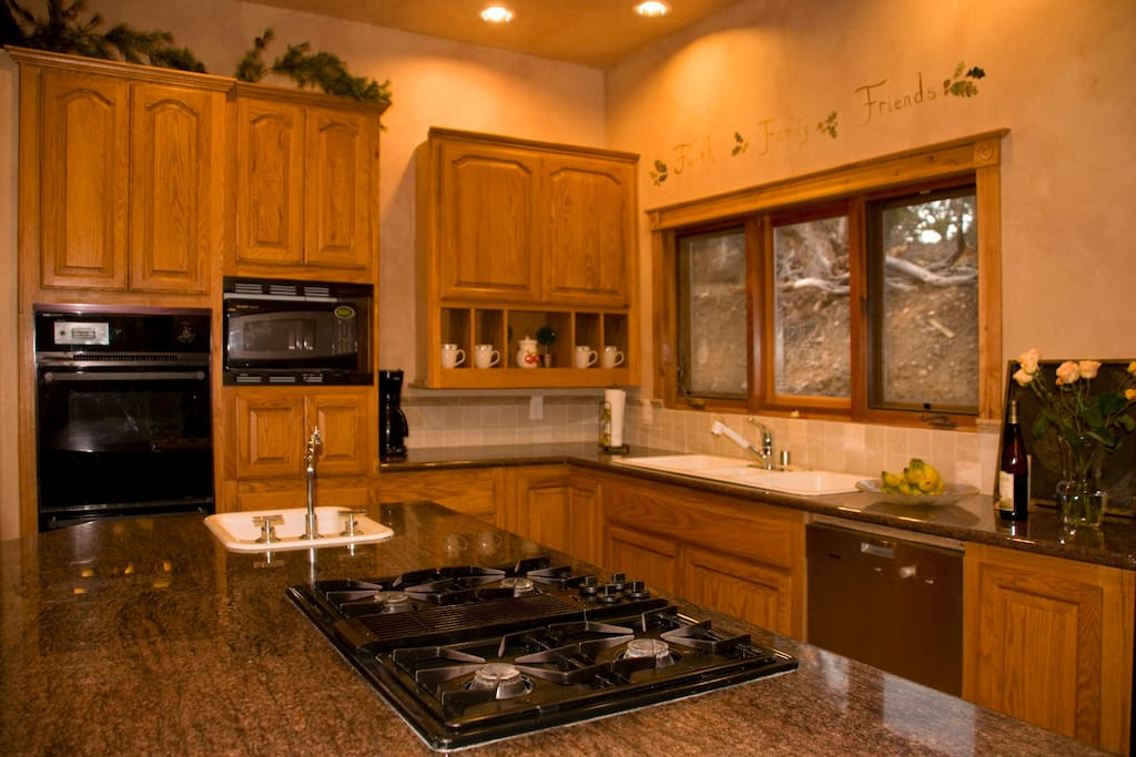The large kitchen has granite countertops, two sinks, side by side fried, oven, broiler, microwave and dishwasher.