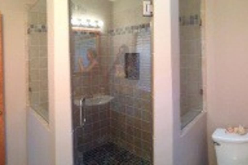 Brand new walk in shower with tile and leaded glass. (Downstairs)