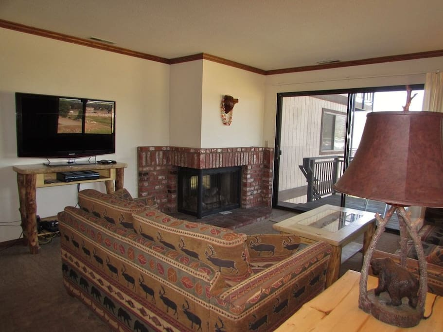 Main Living Area With Gas Fireplace and a Flat Screen TV w/ Cable