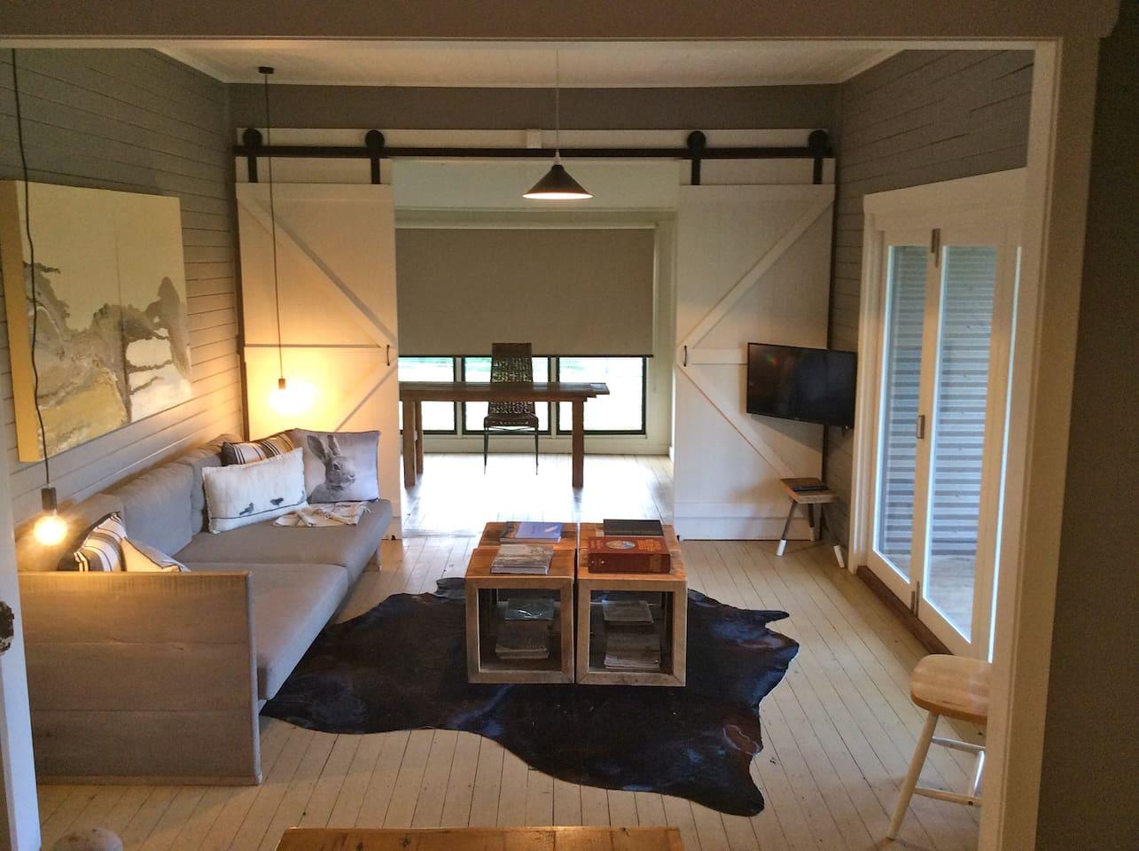 open plan living opening onto verandah and beyond……