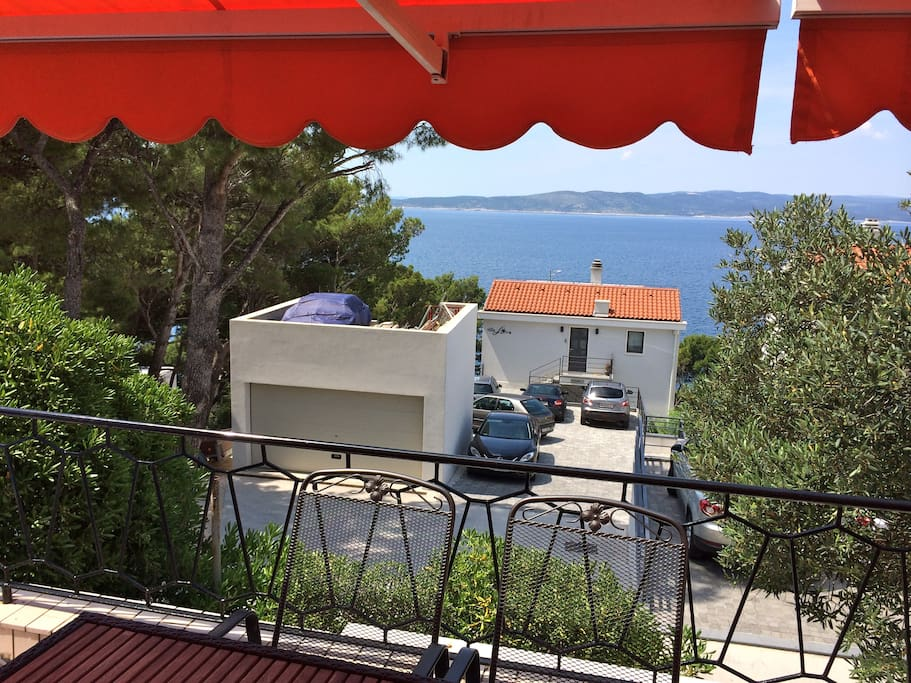 Terrace view with extendable awning providing plenty of sun coverage