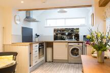 The bright and light country kitchen area has ample work space to cook a meal for two.