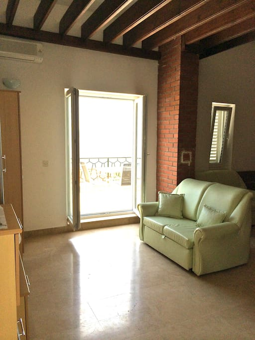 Living room area with entrance out onto the terrace