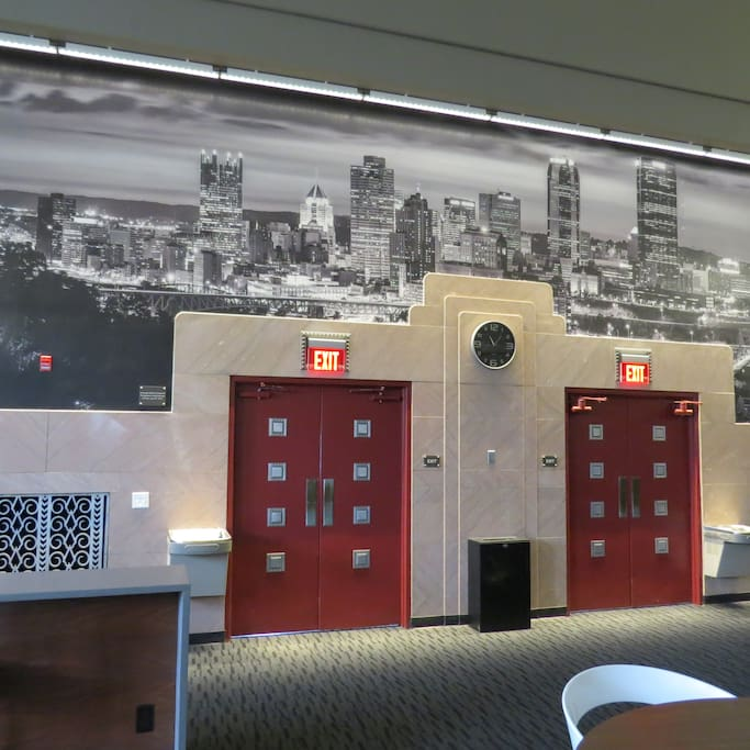Lobby kept the charm of the old school with original doors and a painted Pittsburgh Skyline