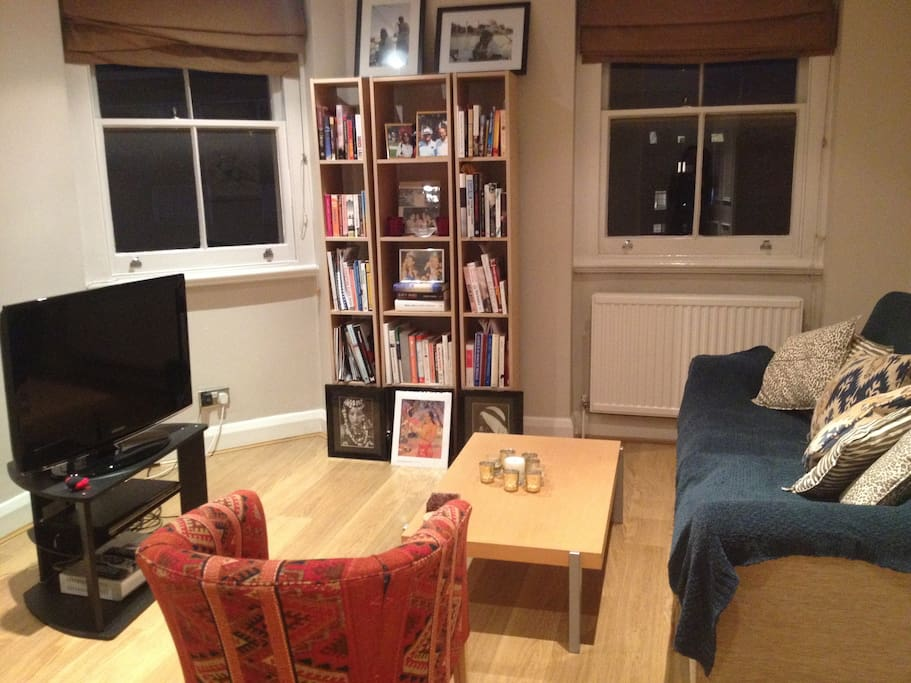 Fabulous living room with TV and bookshelf, and 2 windows overlooking the buzzing Harrington Road in South Kensington. 2 minute walk from the SK Tube station, museums, and restaurants. Best location ever.