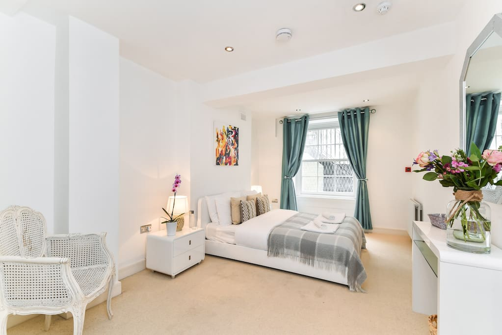 The spacious master bedroom, with king sized bed and ensuite bathroom.