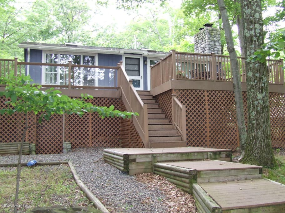 Back of the house - deck over looking the lake;  have a birds eye view of nature and your kids on the lake