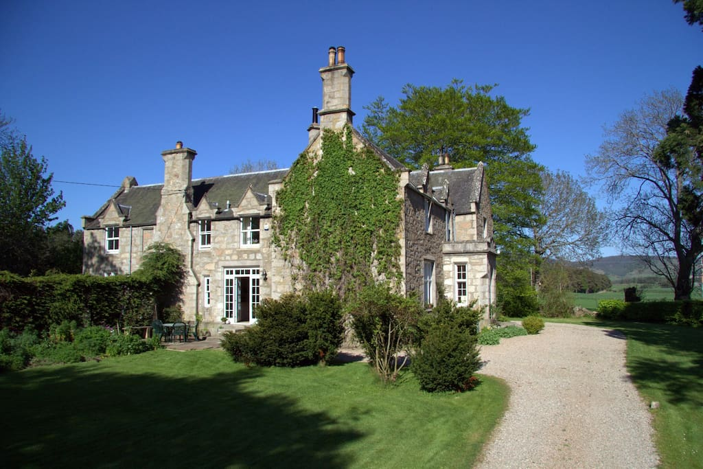 Traditional granite house in own gardens.