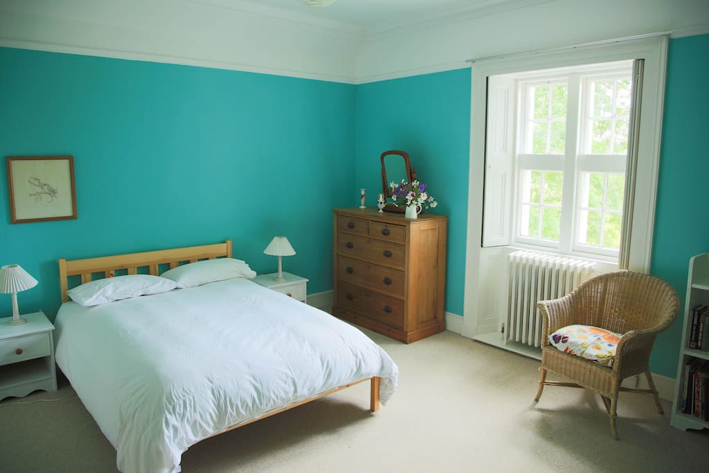 Spacious double room with views towards Tomnaverie Stone Cicle. Shared bathroom.