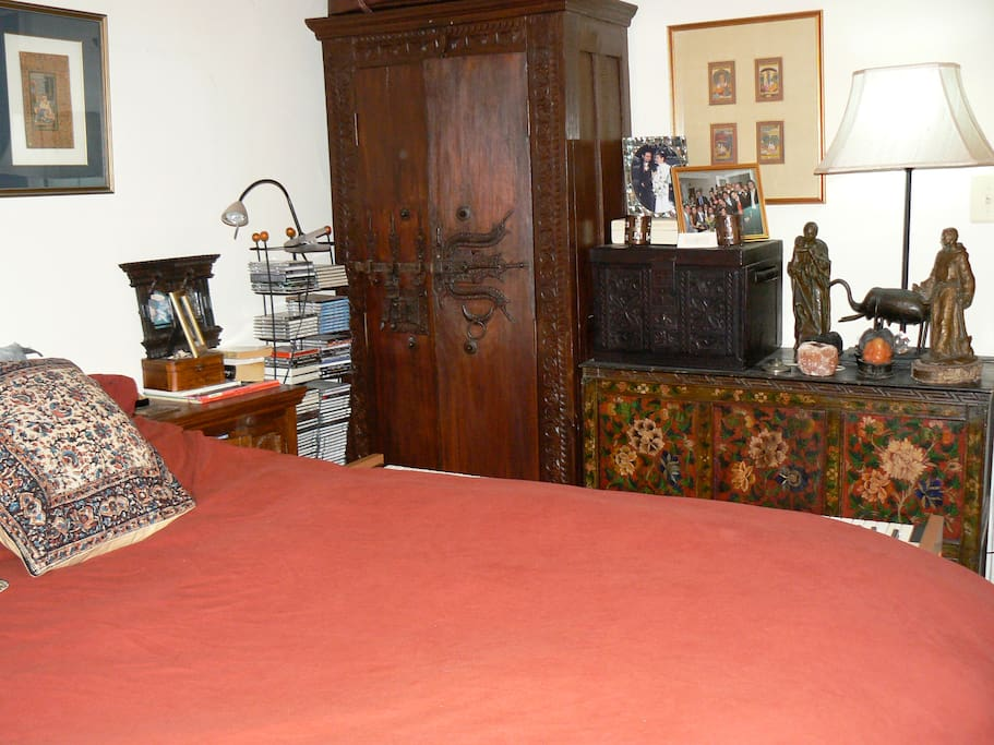 Bedroom with queen size bed, Indian and Tibetan furniture
