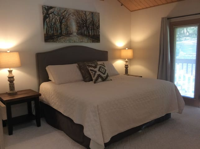 The master bedroom is a large loft room with a private balcony overlooking the front yard and driveway.  The room offers a king size bed,  private bathroom with tub/shower combo and large walk in closet.  There is no actual door to close for privacy.