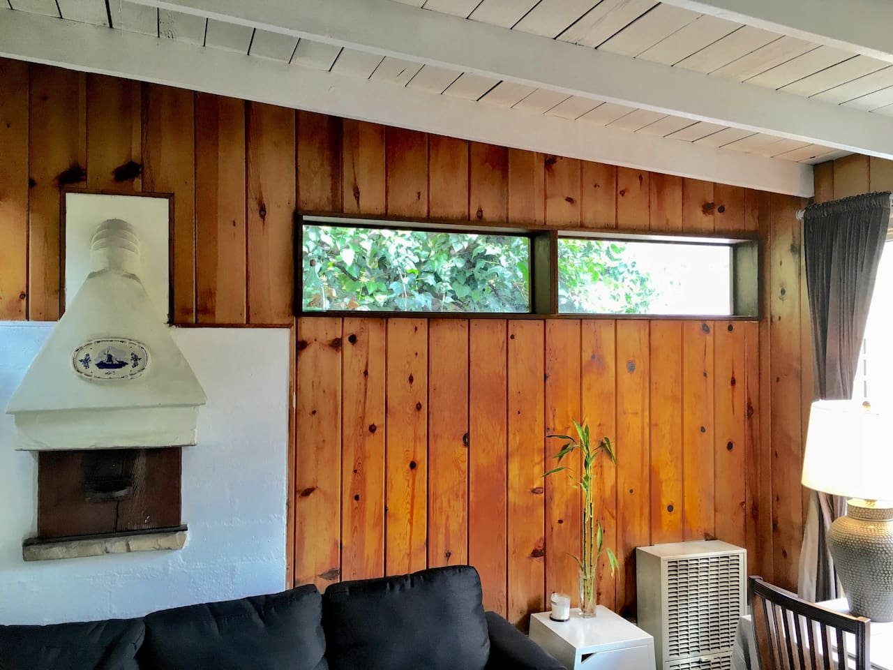 Your warm, Mid-Century cabin hide-away in the hills.