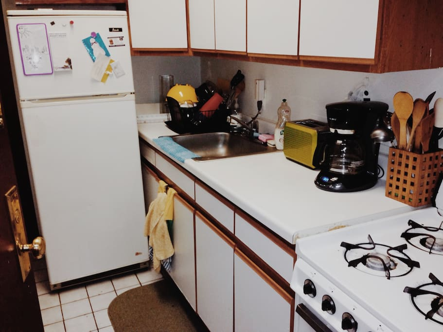 Kitchen with appliances including toaster, coffee maker, blender, etc