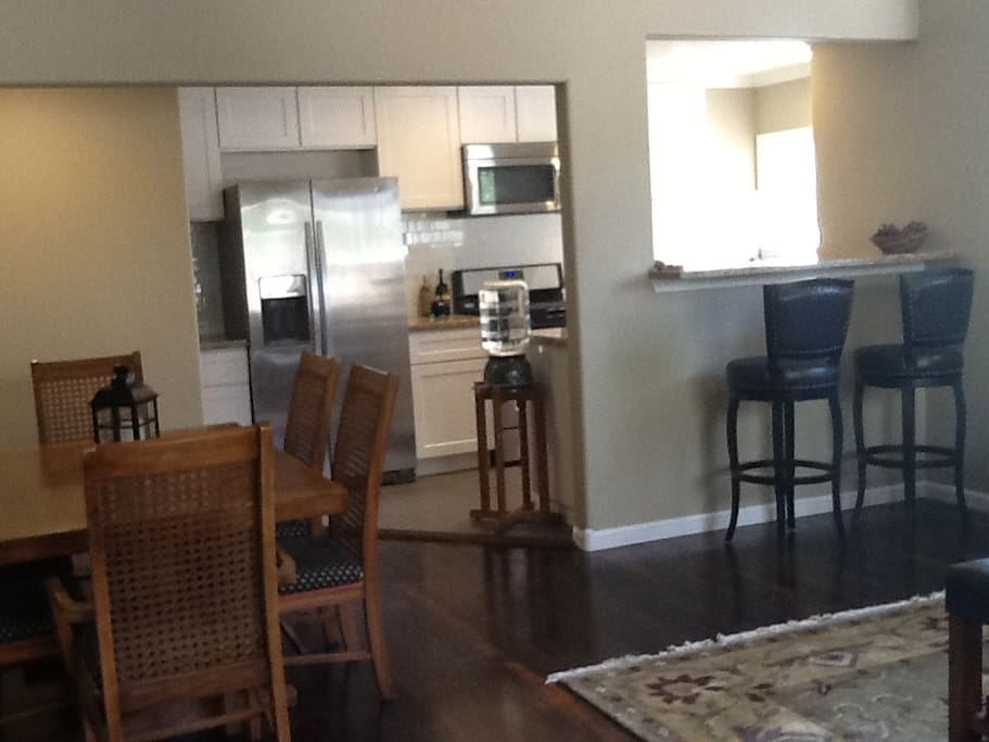 The kitchen is open to the dining table and living room.