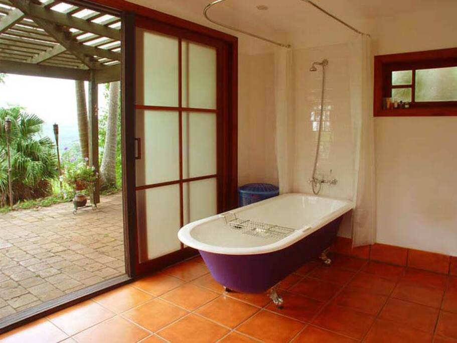hut bathroom looking out to  private terrace
