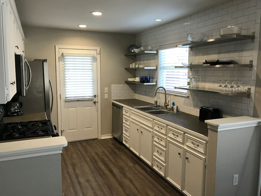 Kitchen area with stove, microwave, oven, dishes, dishwasher, fridge with ice & water.  Also includes toaster & coffee maker.