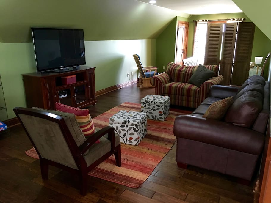 Comfortable living area with wifi, cable tv, wii game system, and AppleTV.