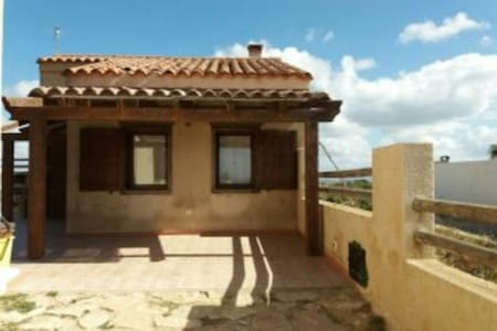 Villa dei Quarzi on the Beach with Ocean View, Terrace & Wi-Fi; Parking Available, Pets Allowed