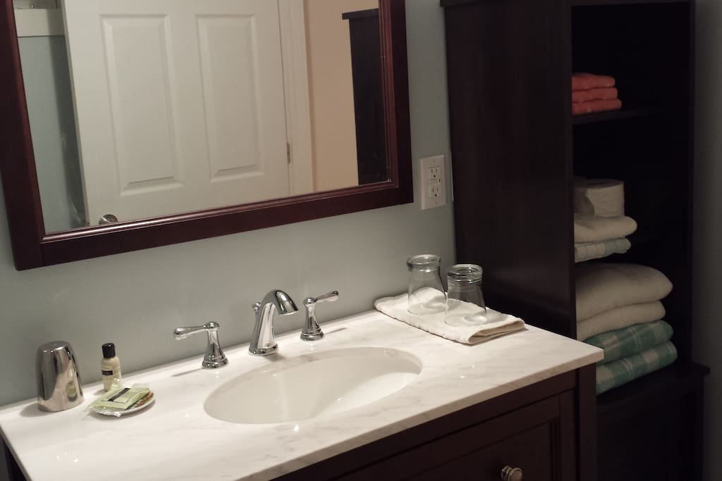 New and very clean bathroom with fresh towels and a few toiletries
