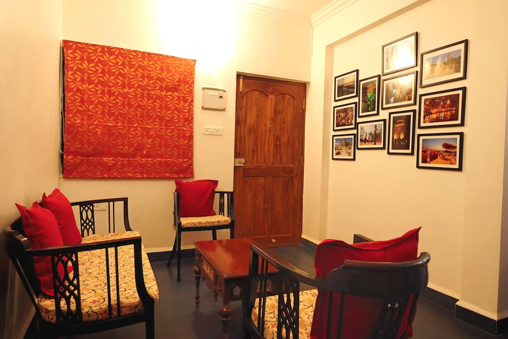 The drawing room with a collection of photographs depicting India.