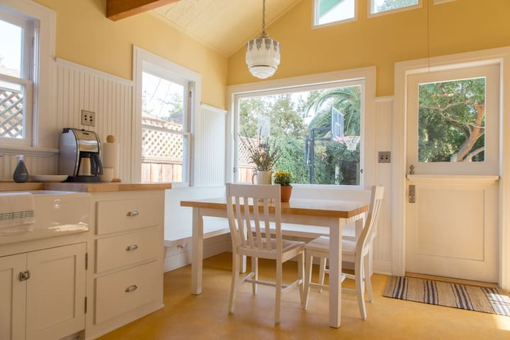 Enjoy a meal at the breakfast nook in gorgeous light. Seats five. Thermal coffee maker grinds beans (provided) and makes a great cup.