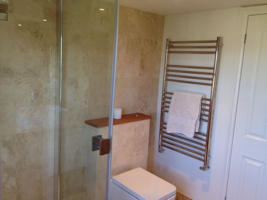 Private modern ensuite shower room.