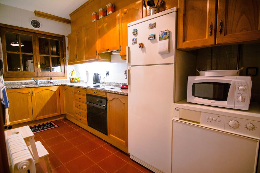 Fully equipped kitchen including oven stove fridge and microwave