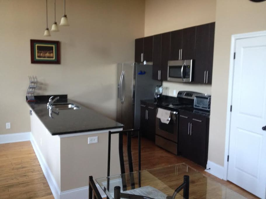 All brand-new stainless steel appliances, and granite countertops with plenty of room.