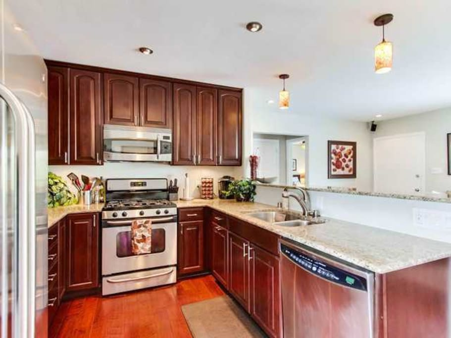 Fully equipped kitchen with stainless steel appliances and granite counter tops!