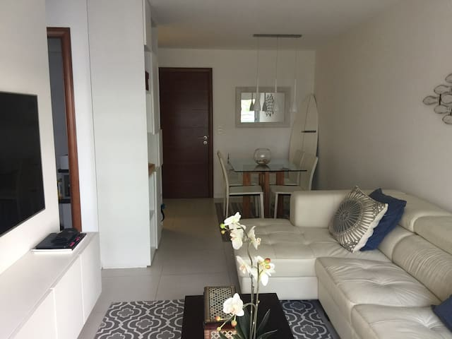 Living room. Strong, Fast WiFi in all the apartment. Confortable and Practical Spaces. Super confortable sofa. Turns into a raised double bed. AC, TV (built in-netflix), Apple TV (entertainment system), Bluetooth Speakers.