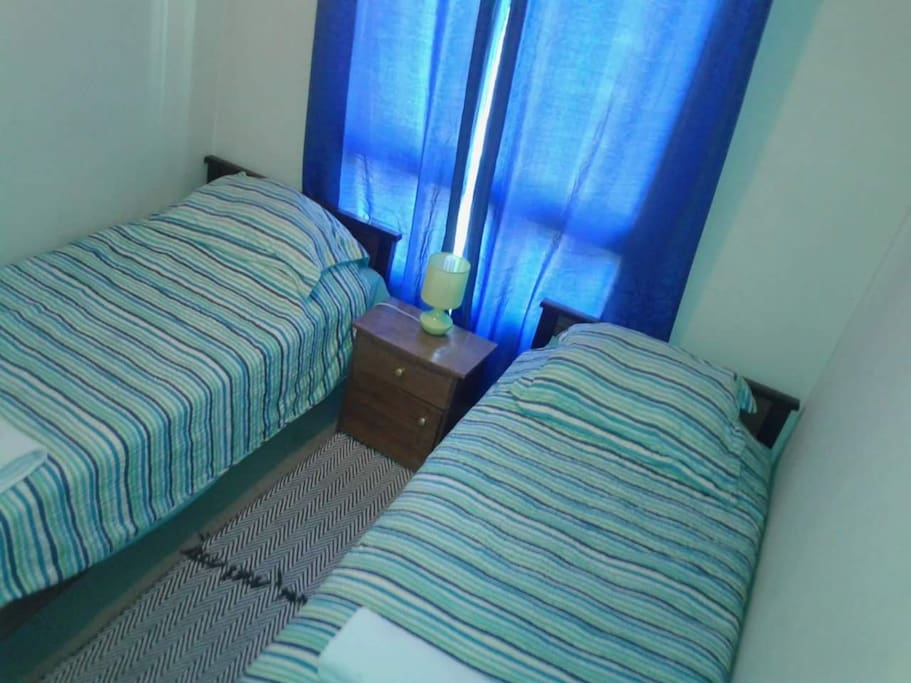 Dormitorio 2 con dos camas de plaza 1/2