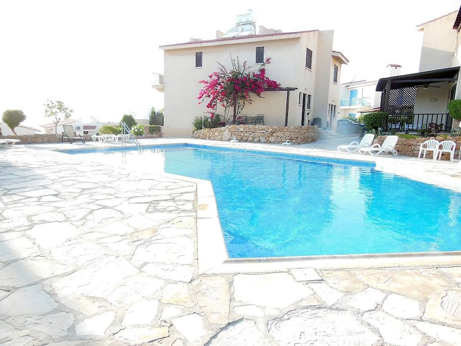 Gorgeous swimming pool in daytime with sea views