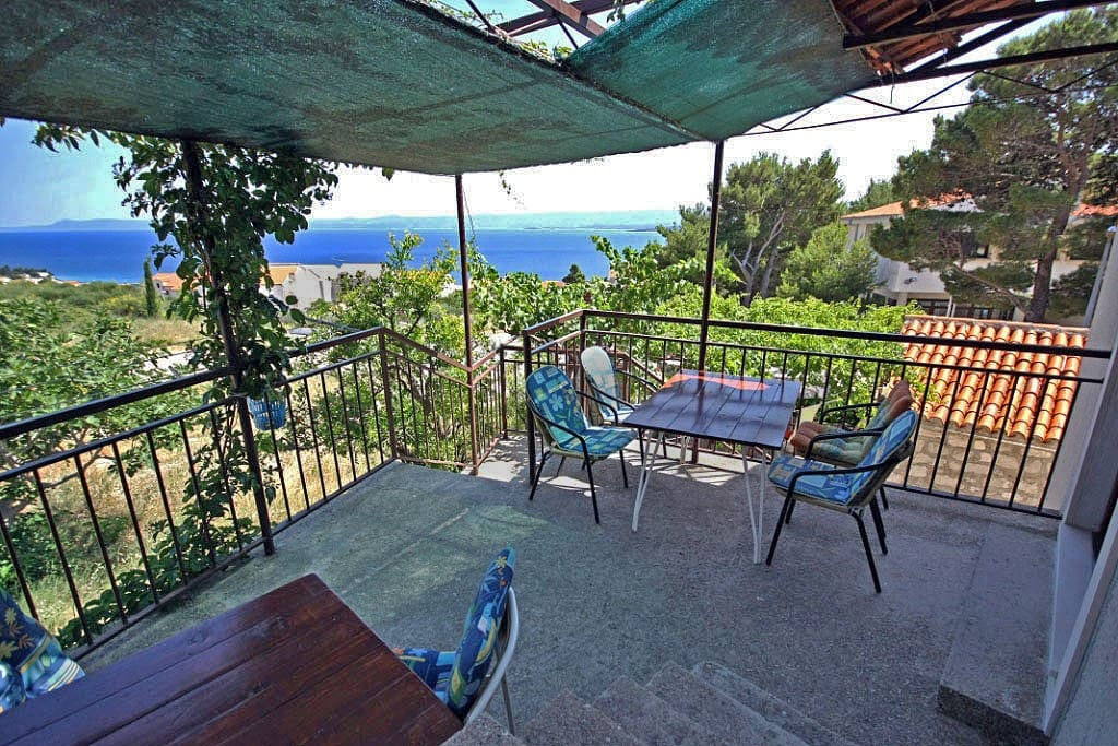 Terrace with belonging table, chairs and beautiful sea view